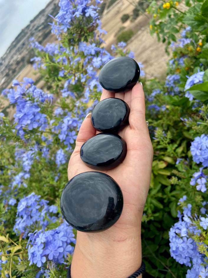 black obsidian palm stones